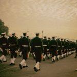 people in cadet uniform walking in line